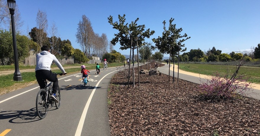 Family riding along California's Cross Alameda Trail through Jean Sweeney Park | Photo by Laura Cohen and Rolf Bell