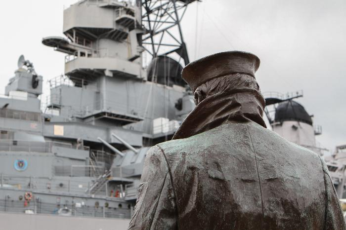 A U S Navy Bluejacket With Hands Stuffed In His Peacoat Keeps Eternal Watch Over The Wisconsin Lone Sailor Is An Exact Replica Of Original Statue