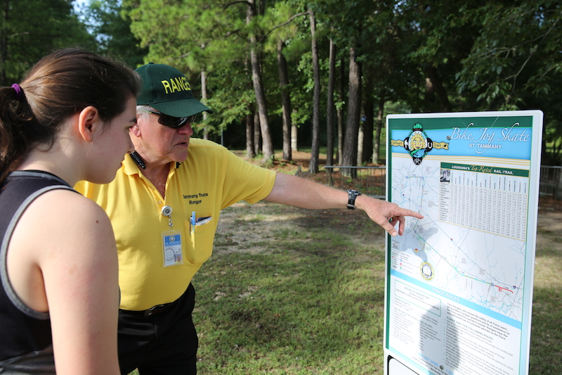 Tammany Trace Ranger Al Kurtz helps a patron on the trail | Photo courtesy St. Tammany Parish
