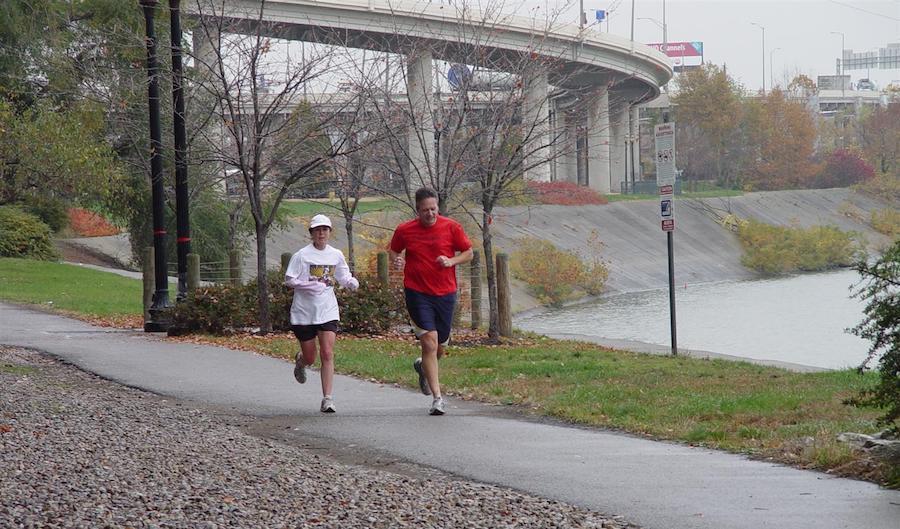 People jogging along the Louisville Loop Riverwalk | Courtesy of Louisville Parks and Recreation