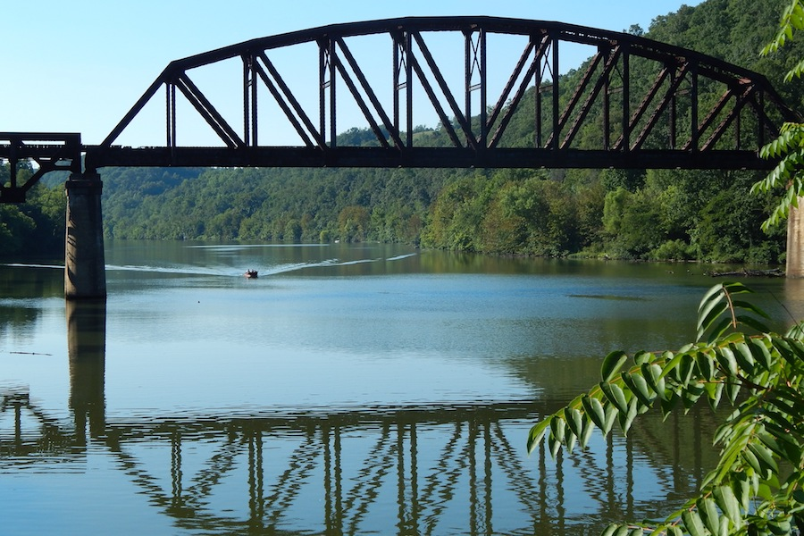 Railroad bridge crossing the Mon River seen from the Mon River Trail | Photo by Ella Belling