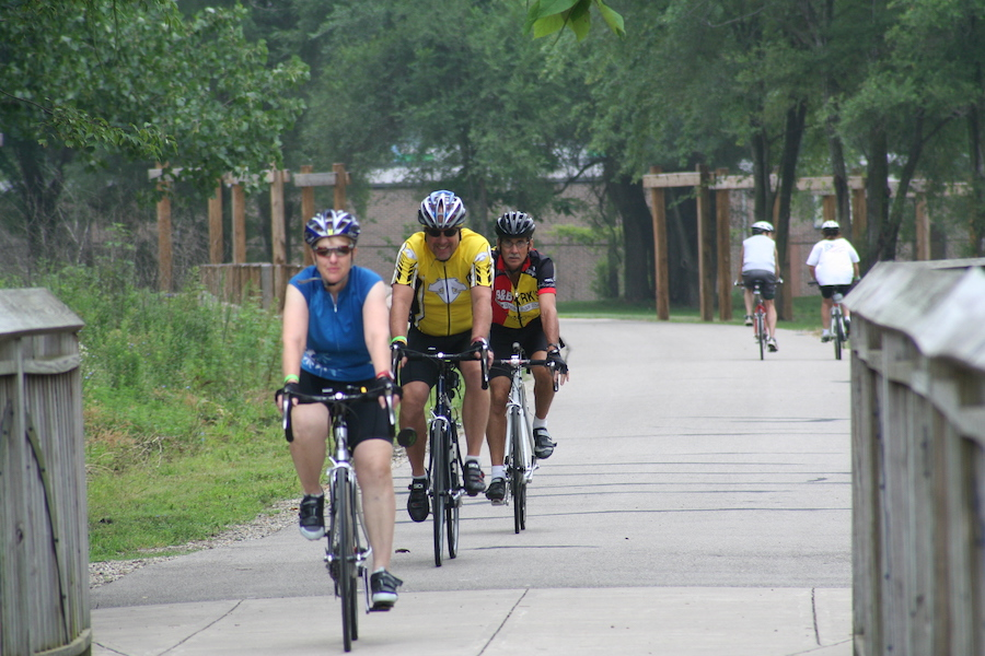 Bike riders on Cardinal Greenway, North of the Muncie Depot | Photo by Angie Pool, courtesy Cardinal Greenways Inc