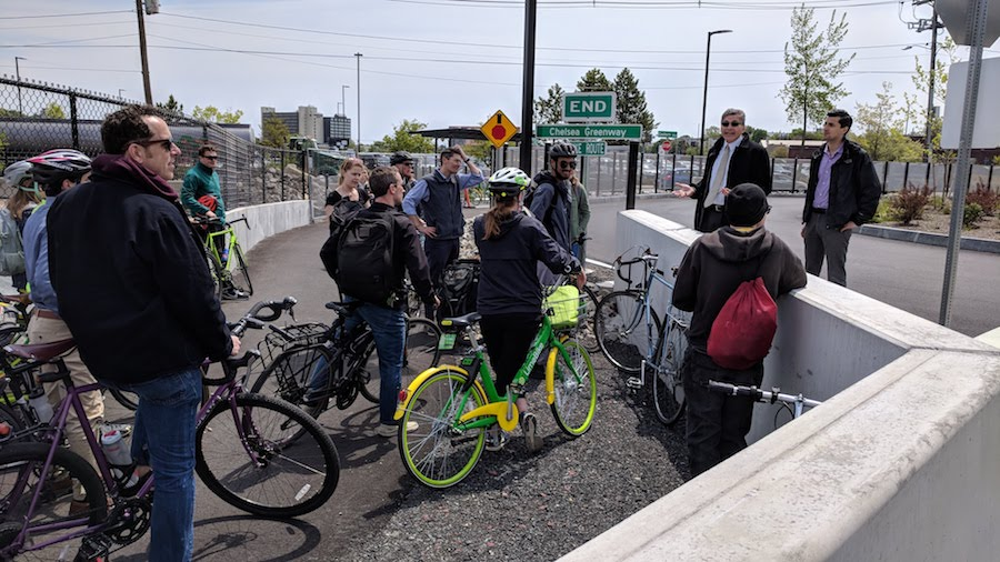 At a bike ride following the rollout of the LandLine Vision Plan in Malden, Massachusetts, riders stop to hear a talk by the Everett City Manager about the newly opened Chelsea Greenway and adjacent Bus Rapid Transit corridor. | Photo by David Loutzenheiser