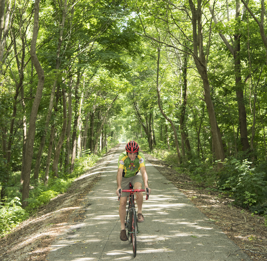 A trail user enjoys a peaceful ride along the Cardinal Greenway near the Medford Trailhead. | Photo by Tony Valainis