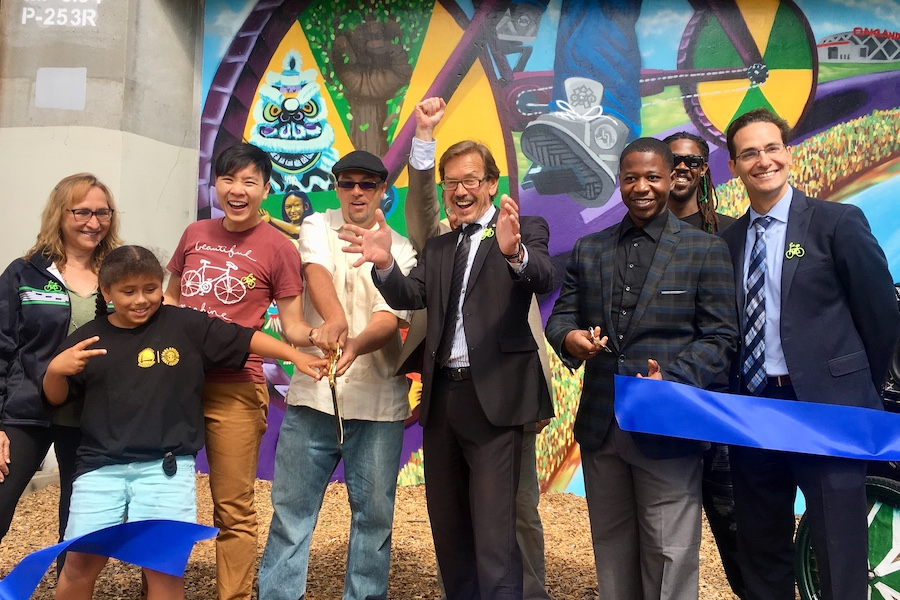 RTC and local partners in California celebrate the launch of two new trail murals in Oakland in 2018, to help promote the developing East Bay Greenway. | Photo courtesy Bike East Bay