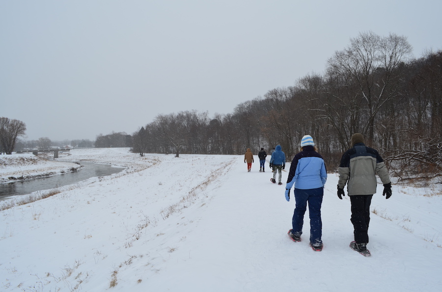 Snowshoers explore the Mahoning Shadow Trail along Punxsutawney's flood-control dike. | Photo by Danielle Taylor