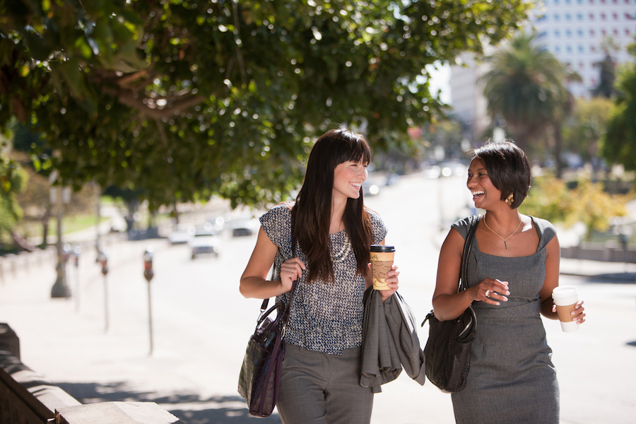 Coworkers walking - Photo courtesy iStock by Getty Images