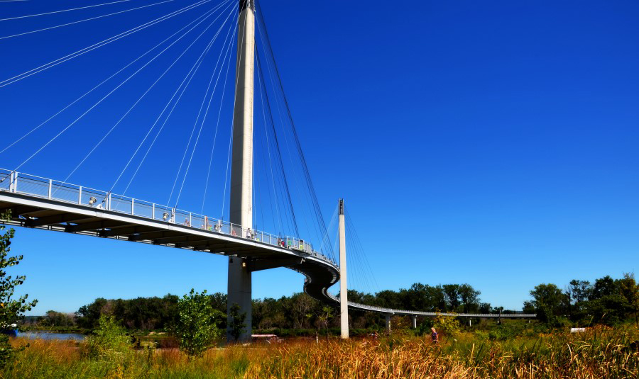 "Bob Kerrey Pedestrian Bridge connecting Iowa and Nebraska | Photo courtesy <a href=""https://www.flickr.com/photos/46355638@N00/9668799216/sizes/l"">John Carrel</a>