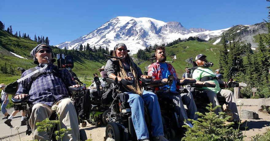 Ian Mackay, founder of Ian's Ride (second from left), at the foot of Mount Rainier | Photo by Teena Woodward